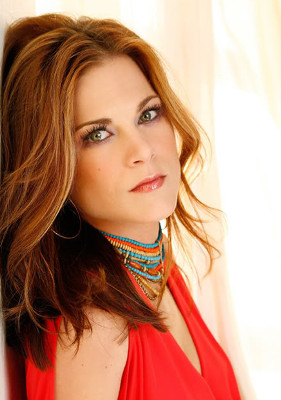 Gina Tognoni with red hair