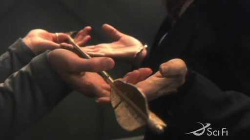 Kara hands over the Arrow of Apollo to Roslin in 'Home'