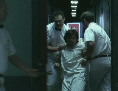 "Clark and men in white coats in ""Labyrinth"""