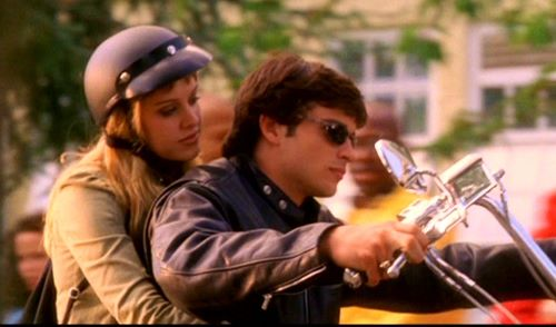 photo of Clark and Jessie on his motorcycle