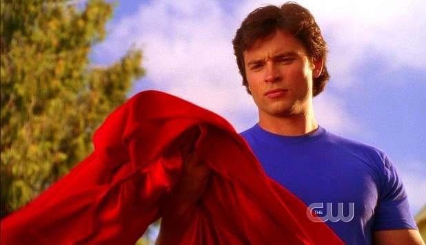 "Clark looking at his new red cape in ""Action"""